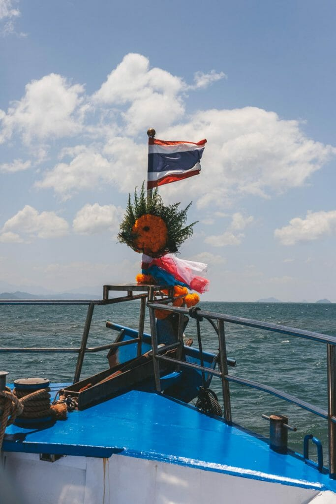 Thai flag and offerings on a liveaboard