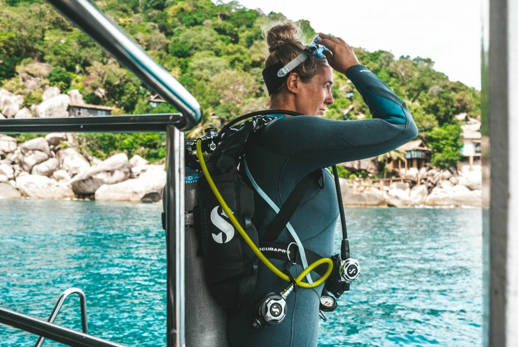 Diver on the boat getting ready for dive